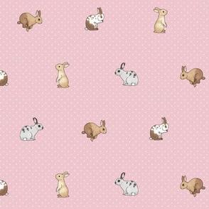 Tiny rabbits and spots white on dusky pink