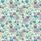 Cute grey koalas with ornaments, tropical flowers and leaves.