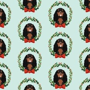 cavalier black and tan coat christmas wreath dog breed fabric blue