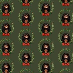 cavalier black and tan coat christmas wreath dog breed fabric green