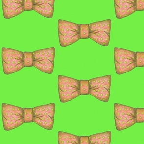 Tempo's  orange bow tie on green