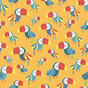 Toucans on a yellow background. Tropical bird pattern.