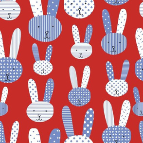 Bunnies blue and white on a red background. Collage bunnies. Doodle bunny. Blue rabbit. Cute babies and children's fabric
