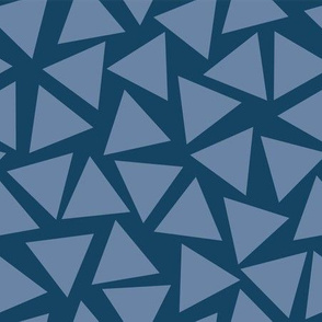 Blue triangles. Scattered light blue triangles on a dark blue background. Randomly placed triangles. Geometric pattern.
