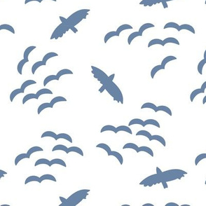 Silhouettes of flying birds. Bird silhouettes blue on a white background. Flock of birds. Swarm of birds. Eagle. Seahawk.