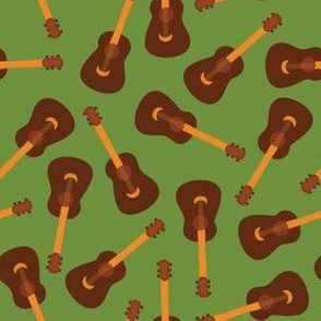 Ukulele print. Acoustic guitars on a green background. Music instrument.
