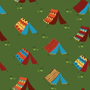 Teepee tents on a meadow. Camping tents on a green background. Boho tent. Hippie tent.