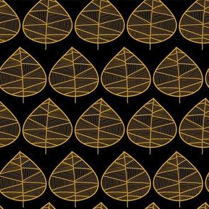 Golden doodle leaves on a black background.