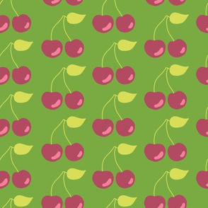 Pairs of cherries on a green background
