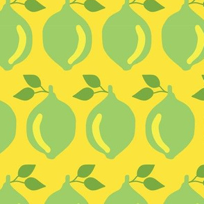 Limes in a row on a yellow background