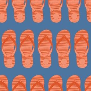 Orange flip flop shoes on a blue background.