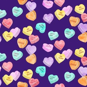 valentines day heart candy - conversation hearts on dark purple