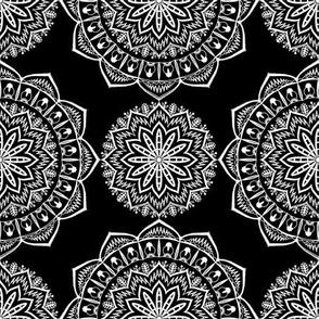 white mandalas on black