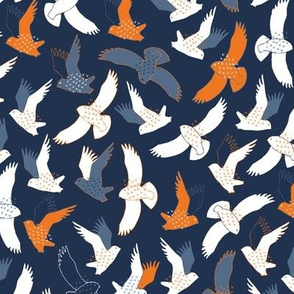 Snowy Owls In flight - white, grey and orange on dark navy