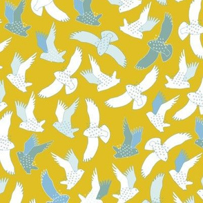 Snowy Owls In flight - white and grey on mustard yellow.