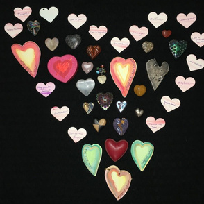 photograph of hearts in shape of heart on black background