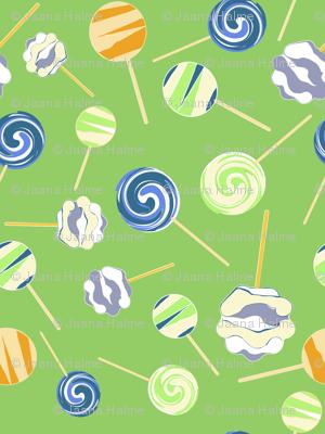 Lollipops on green background