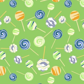 Lollipops on green background