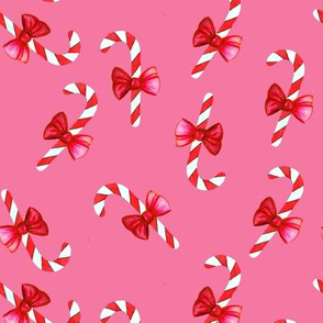 Candy canes with bow on pink