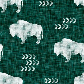 distressed buffalo on dark green linen