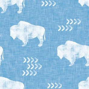 distressed buffalo on baby blue linen