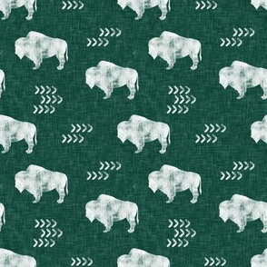 (small scale) distressed buffalo on green  linen