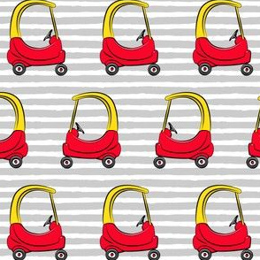 kids toy car on grey stripes (yellow)