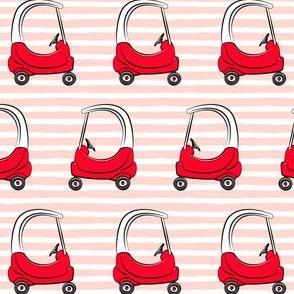 kids car on pink stripes