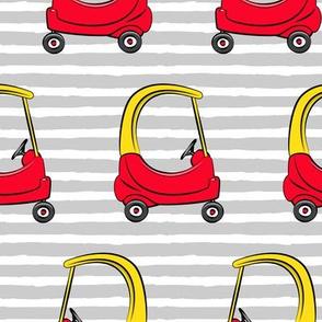 (jumbo scale) kids toy car on grey stripes (yellow)