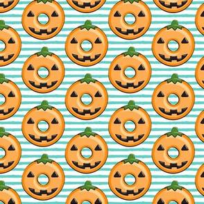 pumpkin donuts on teal stripes