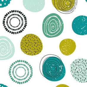 Abstract green, blue and black circles on white background