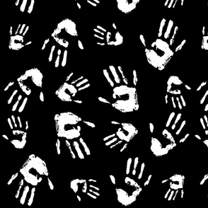 Pattern. Sketch of palm prints of a person. Black background.
