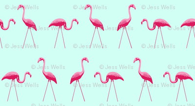 tiny pink plastic flamingos in a row on mint