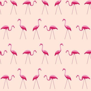 tiny pink plastic flamingos in a row on pink