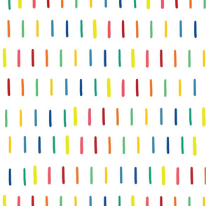 Rainbow doodle strokes in a row on white