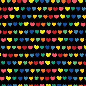 Rainbow doodle hearts on black