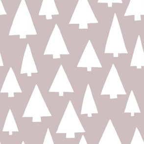 Silhouettes of white Christmas trees on pinkish gray