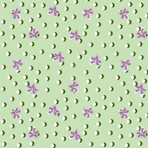 Half moon polkas with flowers purple on green