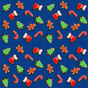 Christmas gingerbread cookies on a knitted background.