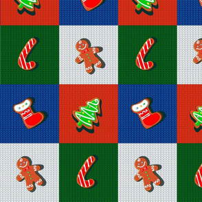 Christmas gingerbread cookies on a knitted background. Checkered wool blanket. Patchwork.