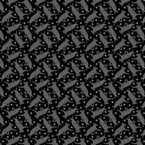 Trotting black German Shepherd dogs and paw prints - tiny black