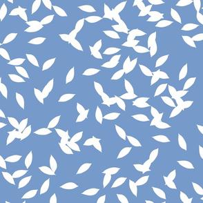 Tossed-white-leaves-on-blue-BG