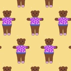 TE_55630_B Teddy bear in sweater of purple flowers on pink with blue trim on Carmel