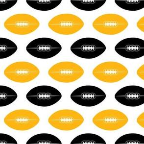 footballs (black and gold)
