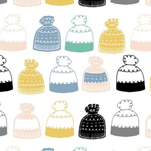 knitted winter hats on white