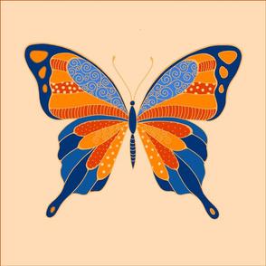 butterfly pillow in blue and orange