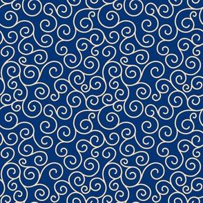 cream curlicues on dark blue