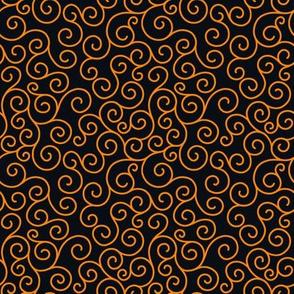 orange curlicues on black