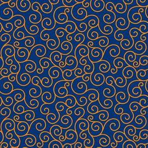orange curlicues on blue