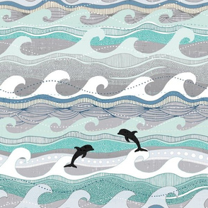 dolphins and waves